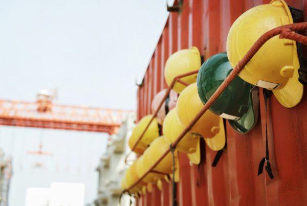 Women in construction hard hats